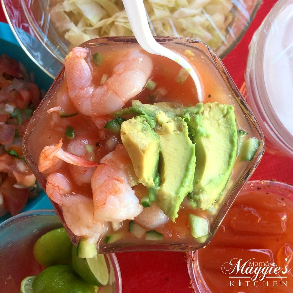 Coctel de Camaron, Mexican Shrimp Cocktail. Pink shrimp and avocado slices in a glass container