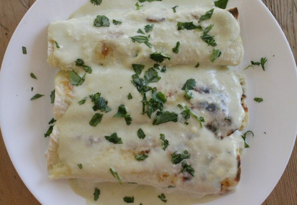 Enchiladas Suizas topped chopped cilantro
