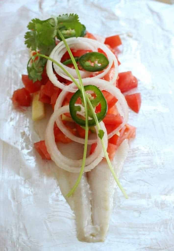 Fish topped with diced tomato, onion, jalapeno, and cilantro