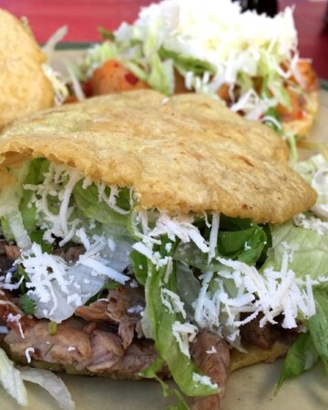 Gorditas stuffed with carne asada lettuce and cheese