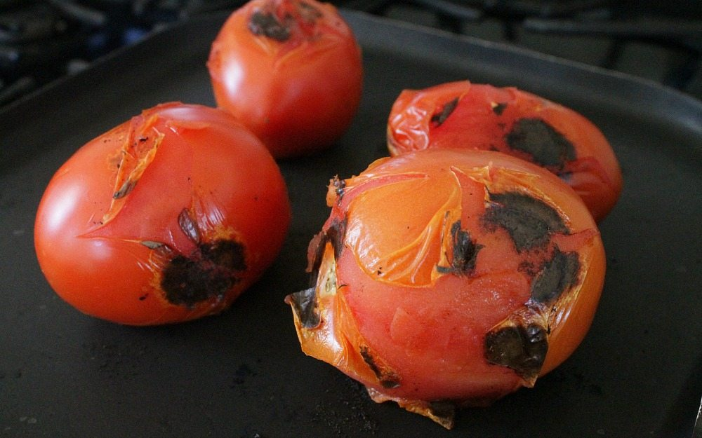 Roasted Tomatoes on a black skillet