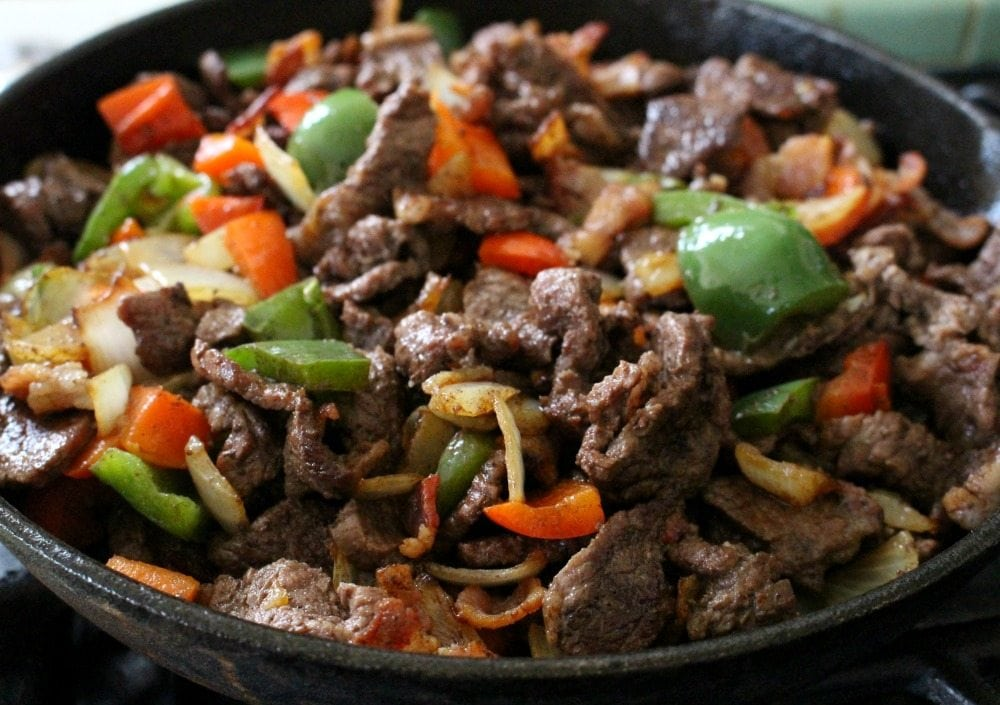 Beef and peppers in a skillet