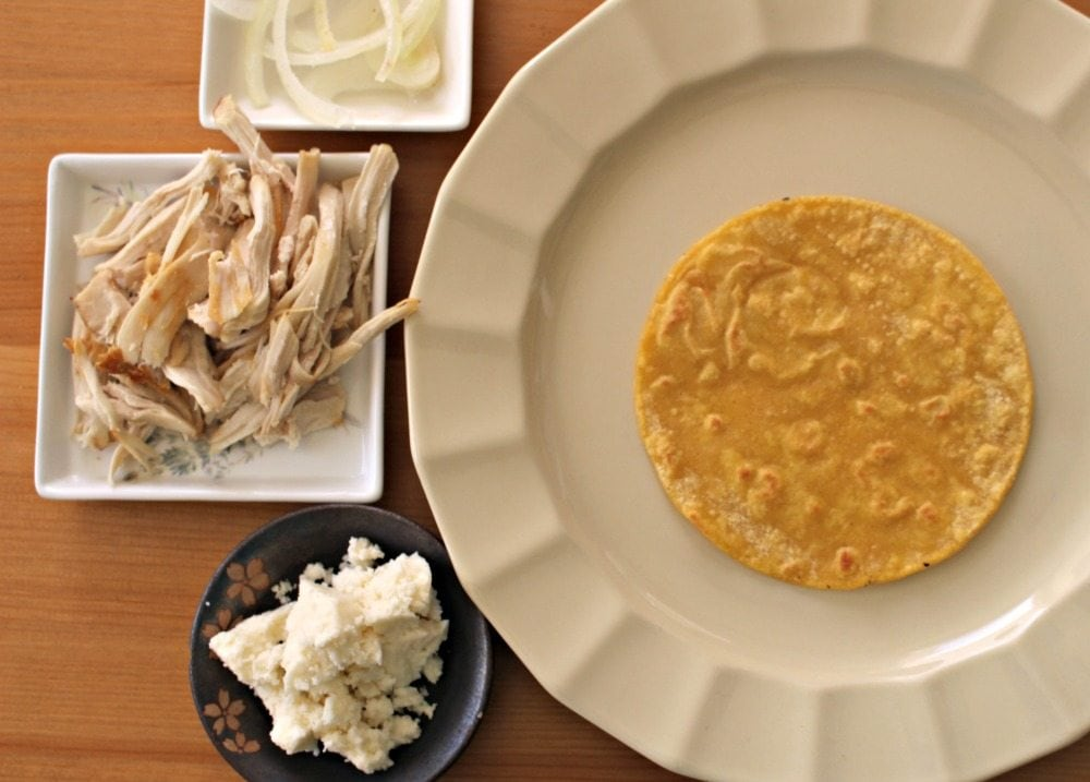 Fried Tortilla, chicken, onion, queso fresco