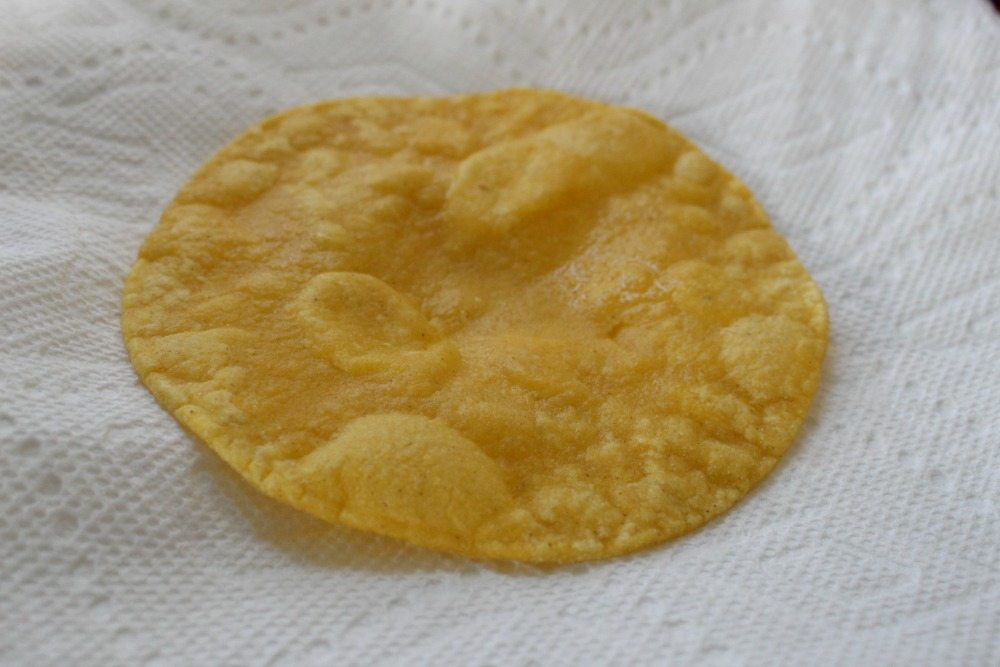 Fried Tortilla on a white paper towel.