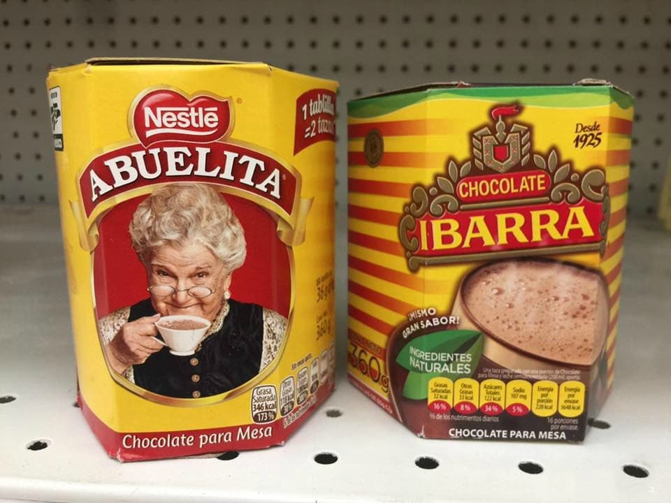 Containers of Mexican Choclate Abuelita and Ibarra Chocolate side by side.