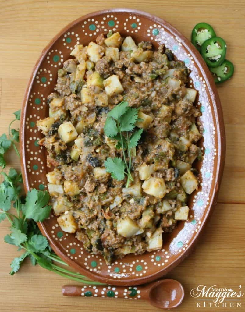 This recipe for Mexican Picadillo is spicy and flavorful. Served with tortillas, rice, and beans. It's a winning dish that's perfect for weeknight dinners and family gatherings. by Mama Maggie's Kitchen