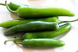 Serrano Peppers on a white plate.