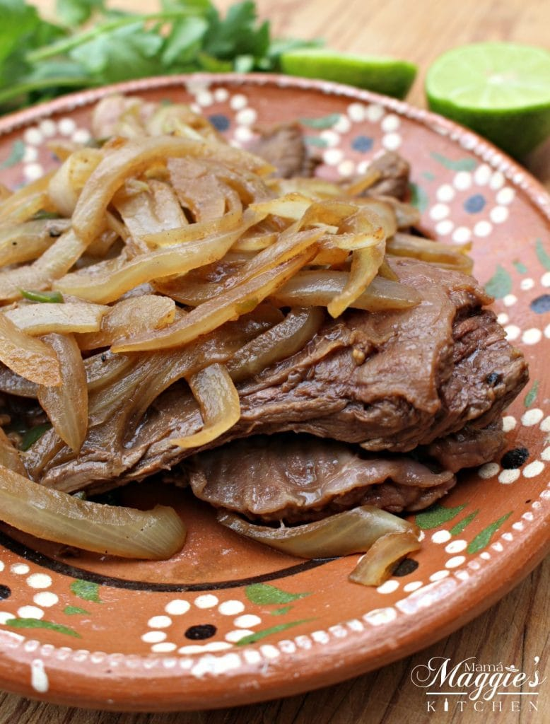 Bistec Encebollado Mexican-Style Steak and Onion on a decorative Mexican plate