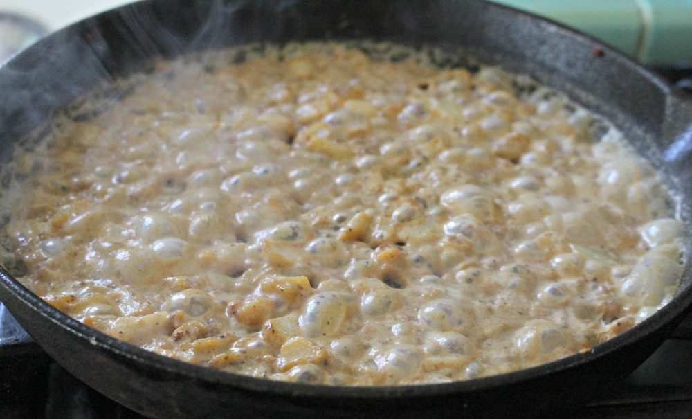 Milk added to onions in pan