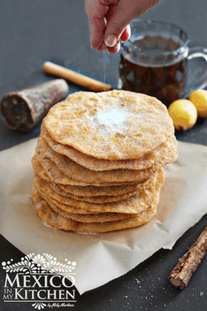Buñuelos are a Christmas treat, Mexican fried fritters topped with cinnamon and sugar by Mexico in my Kitchen