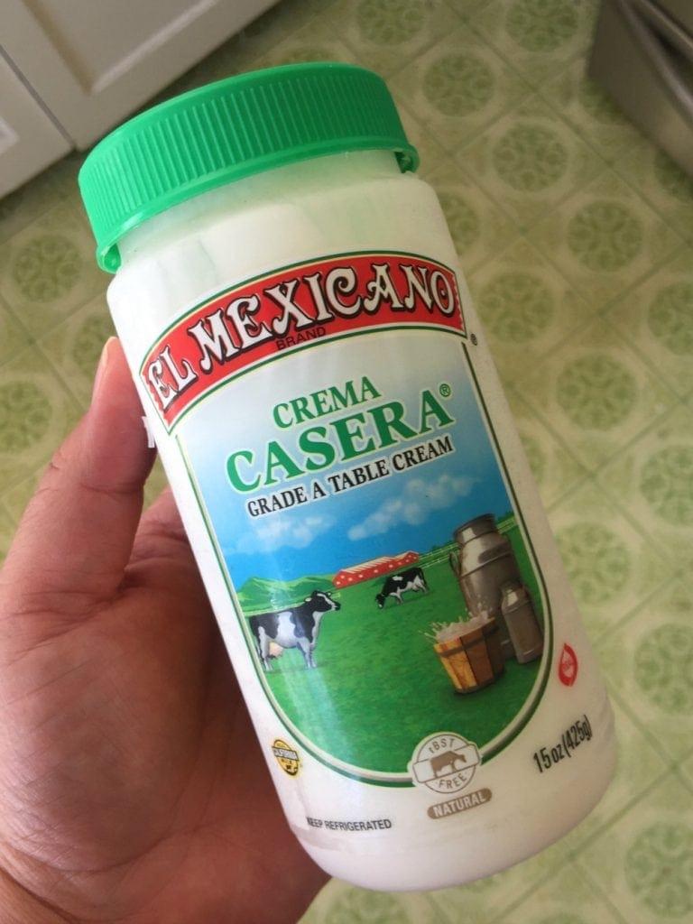 Hand holding El Mexicano Crema Casera