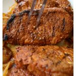 Grilled Pork Chops in Adobo Sauce - Delicious and flavorful. Make this at your next backyard BBQ. by Mama Maggie's Kitchen