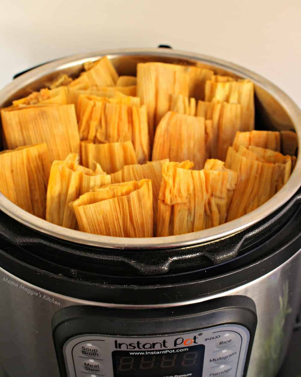 Uncooked tamales in an instant pot without the lid on.