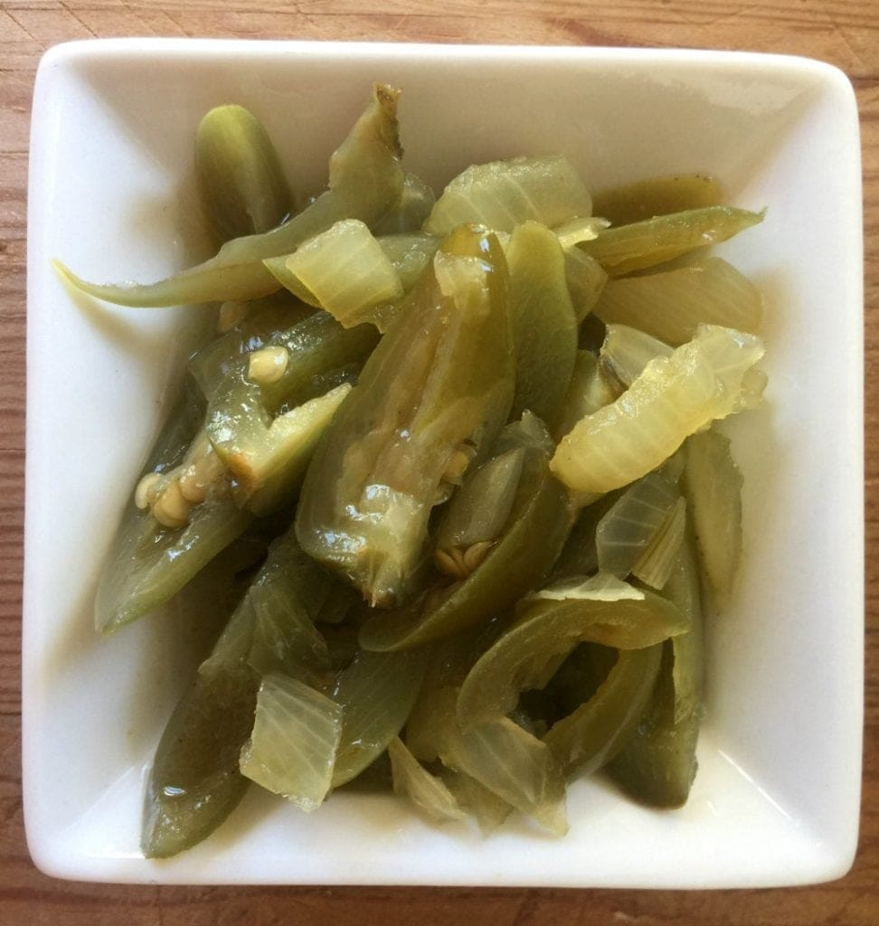Pickled jalapeño on a white plate