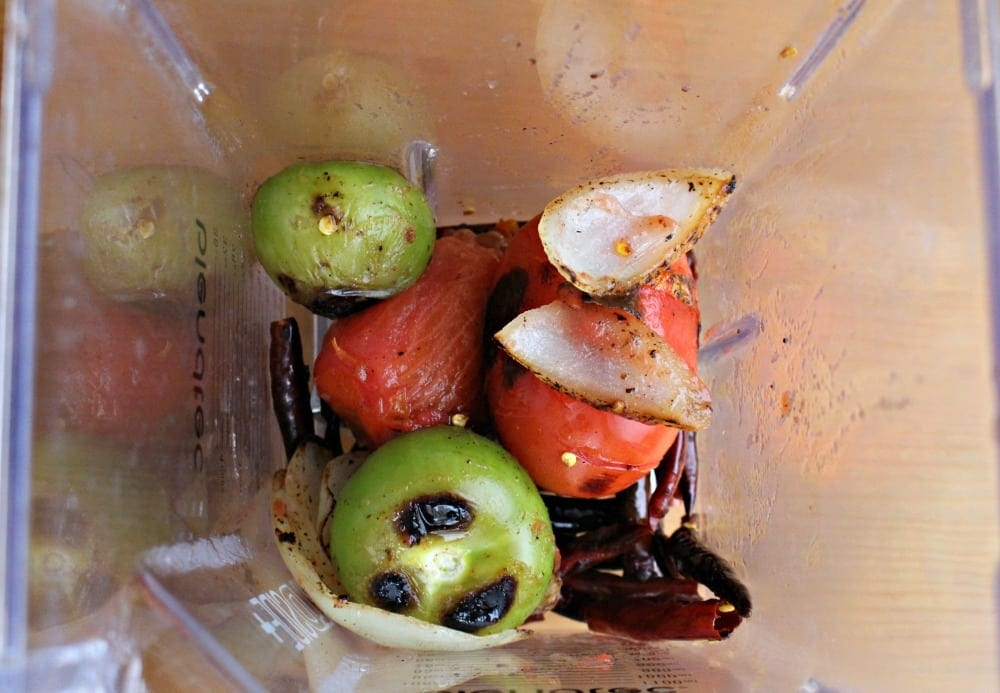 Roasted tomatillos, onion and tomatoes in blender.