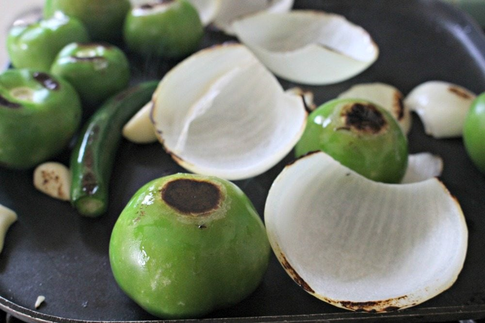 Roasted tomatillos and onions on the stove