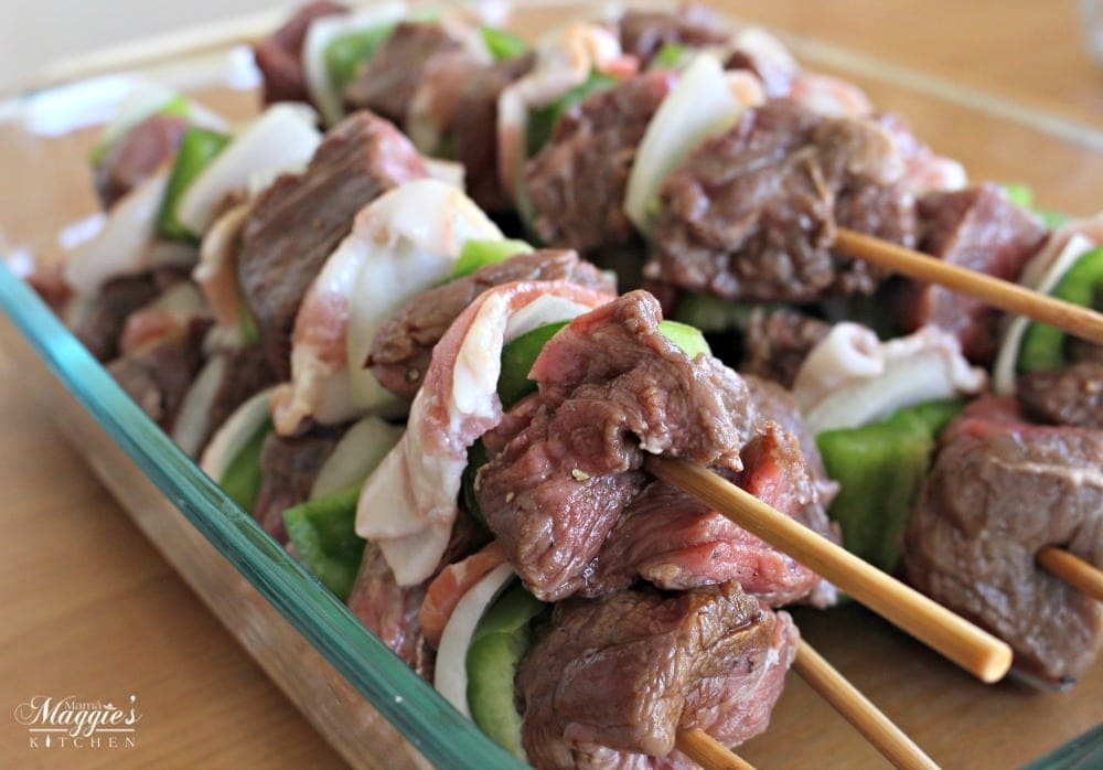 Northern Style Mexican Beef Skewers (or Alambre de Res Norteño) in a Pyrex container
