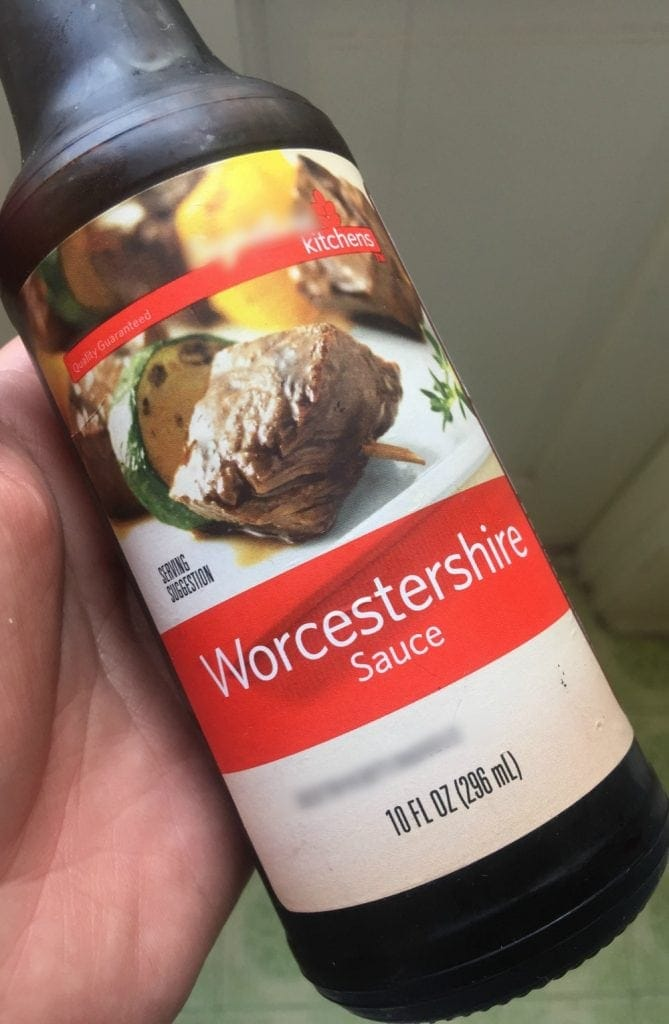 Hand Holding Worcestershire Sauce Bottle