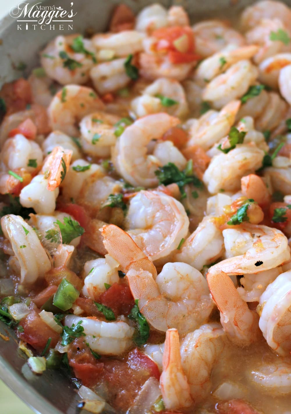 Camarones rancheros also called camarones a la mexicana or ranch-style shrimp in a skillet