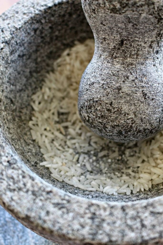 Crushing Rice in Molcajete, or Mexican Mortar and Pestle