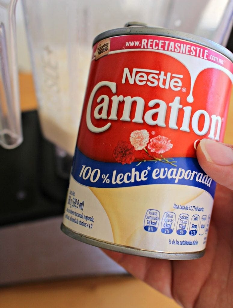 Can of Nestle Carnation Evaporated Milk and blender