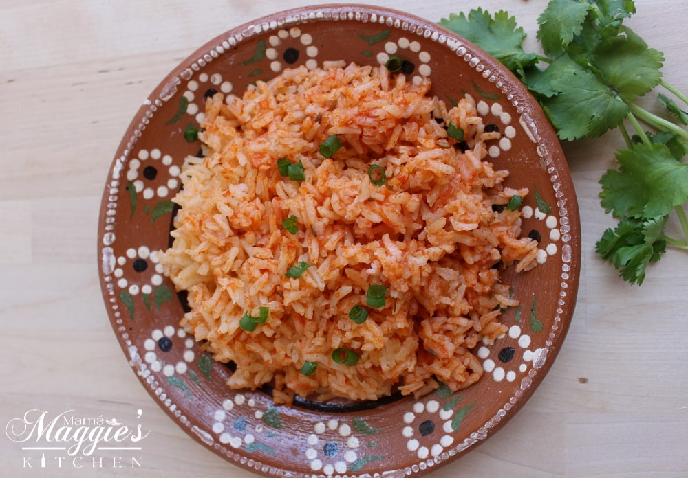 Arroz Mexicano, or Instant Pot Mexican Rice, on a decorative Mexican clay plate and cilantro.
