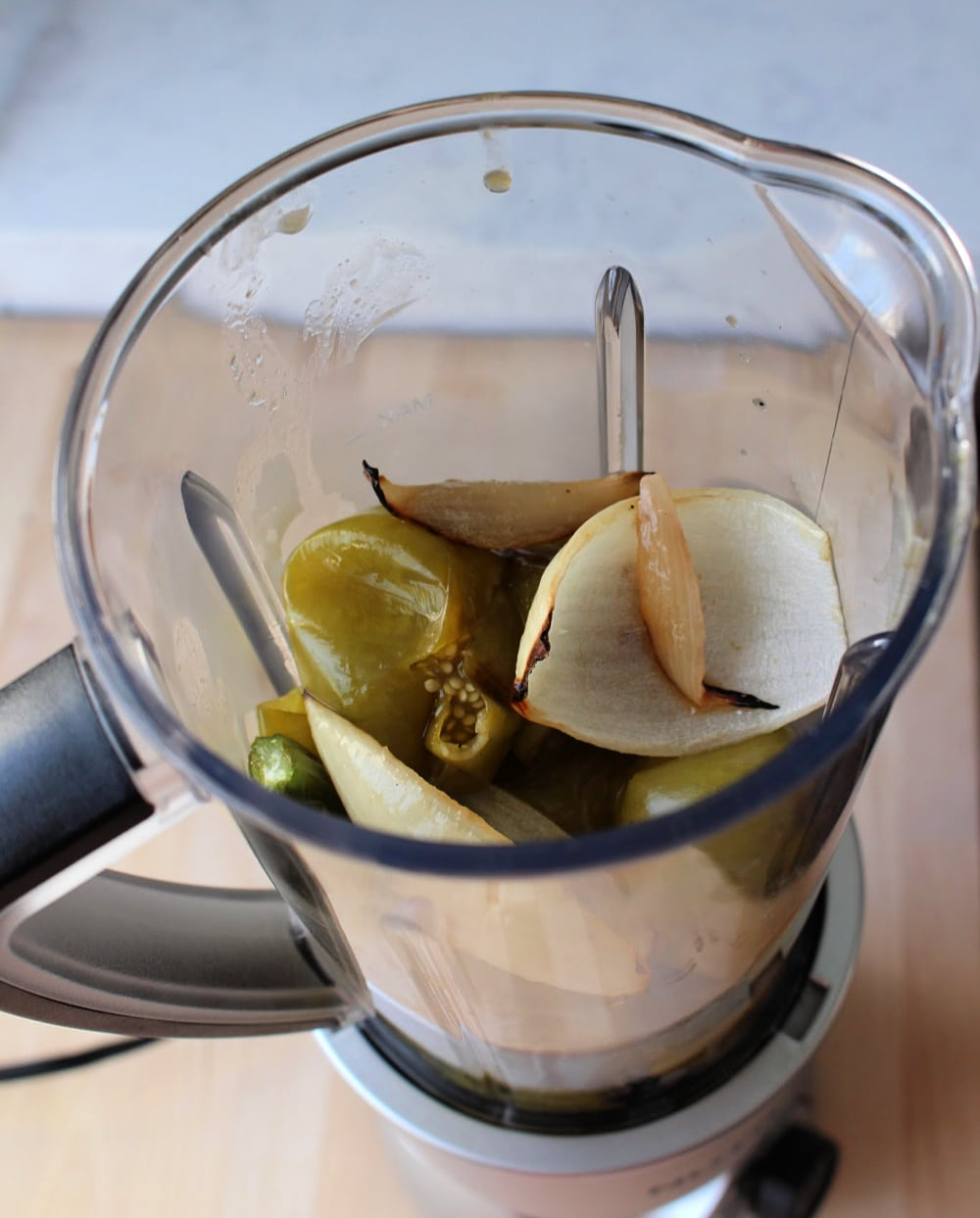 Blender with roasted tomatillos and onion.