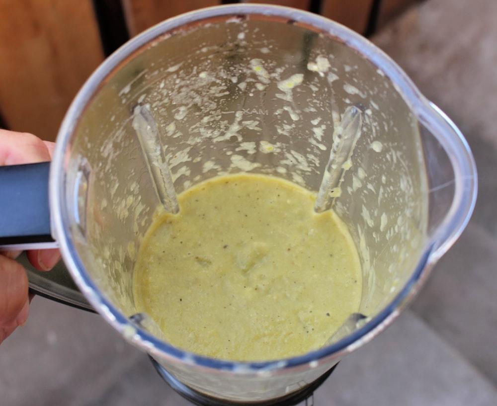 Roasted tomatillos salsa verde in a blender.