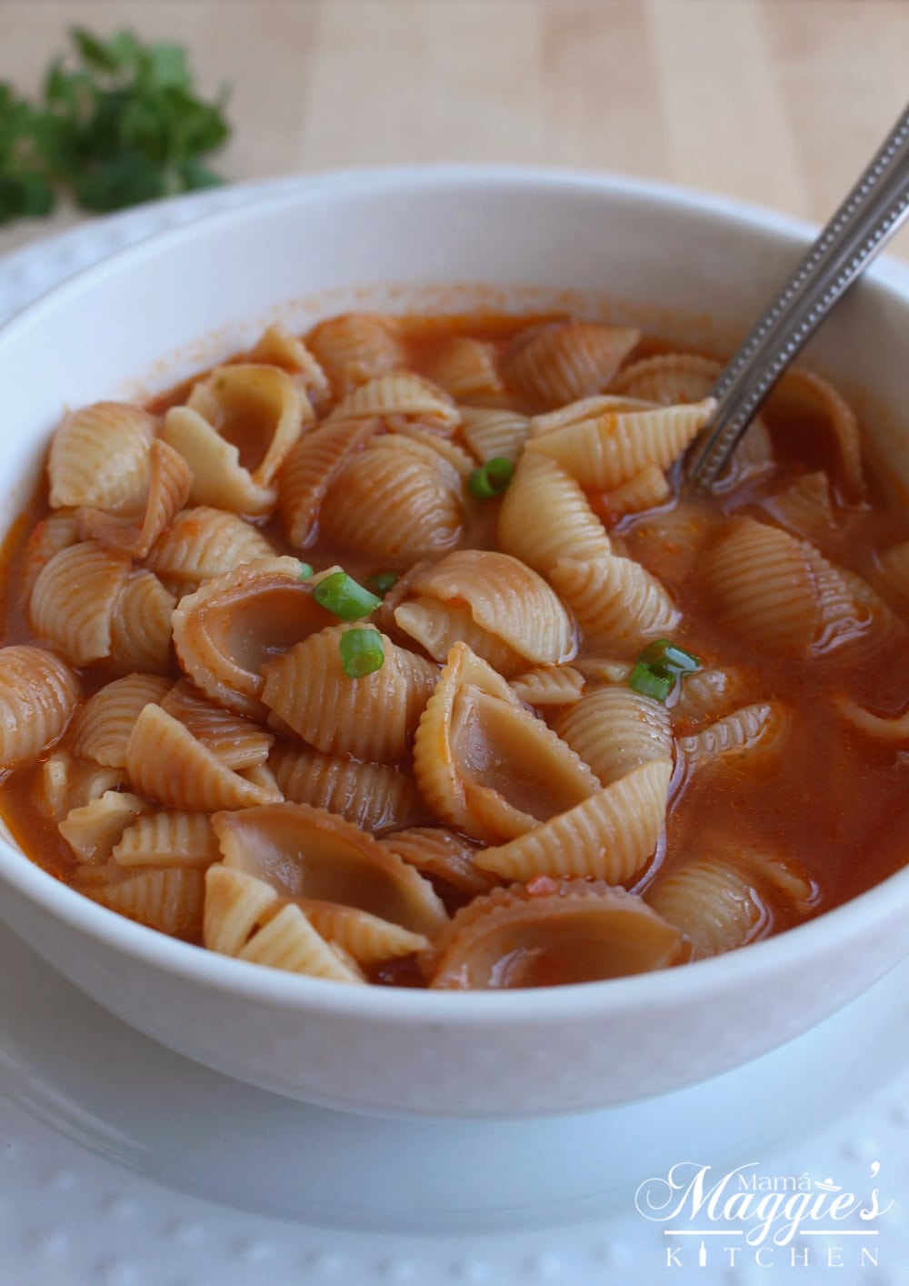 Sopa de Conchas, or Mexican Shell Pasta Soup, in a white bowl.