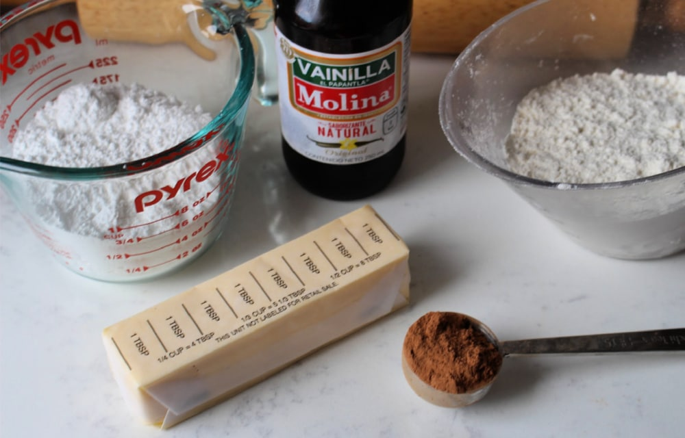 Ingredients for conchas topping on a white surface.
