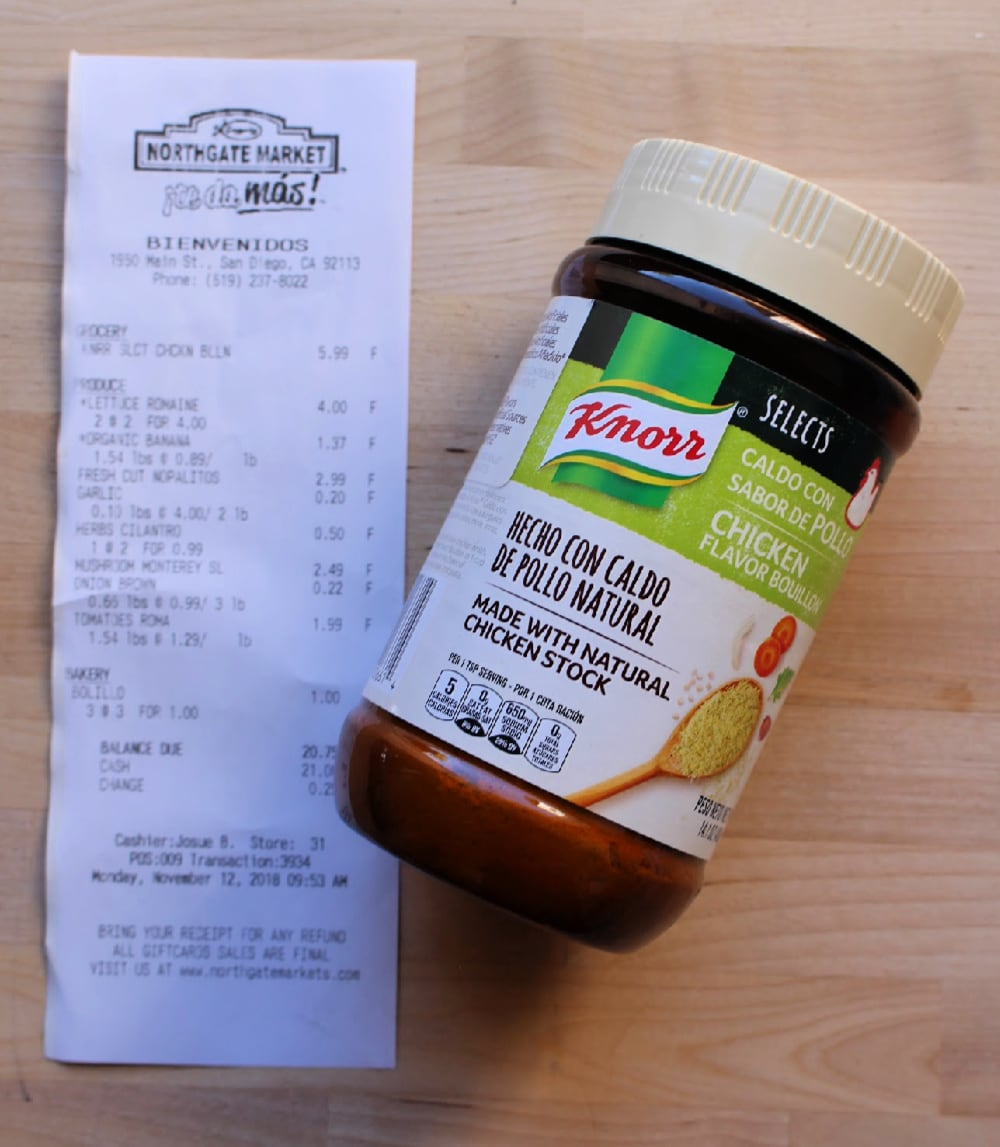 A container of Knorr Select Chicken Bouillon and a grocery receipt.