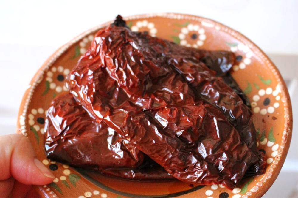 Rehydrated chile ancho on a Mexican clay plate.