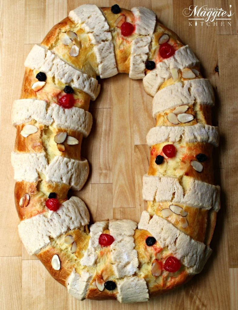 Baked Rosca de Reyes on a wooden surface.