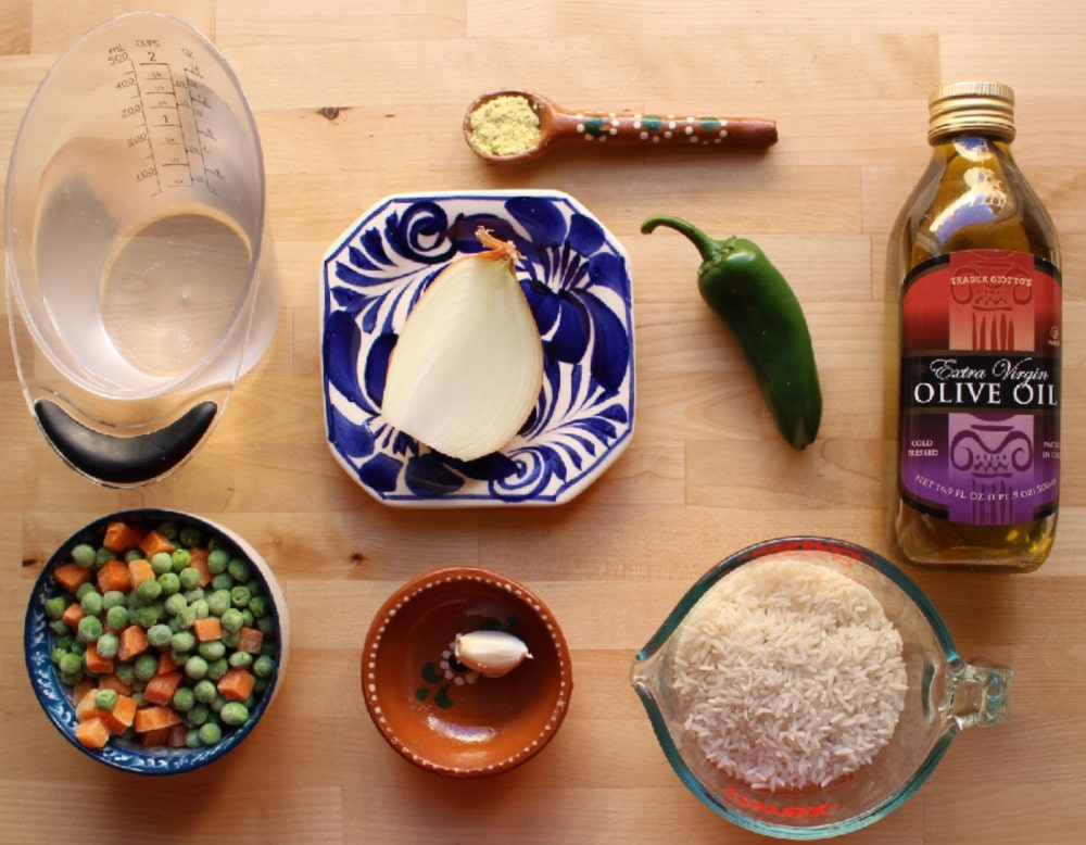 Ingredients for Arroz Blanco on a wooden surface.