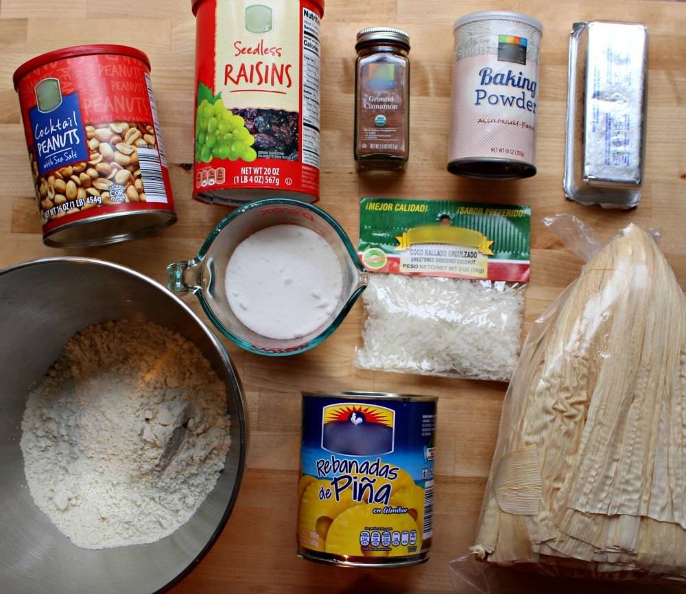 Ingredients for Tamales Dulces on a wooden surface.