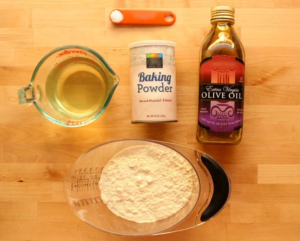 Ingredients tamale masa recipe with oil on a wooden surface.