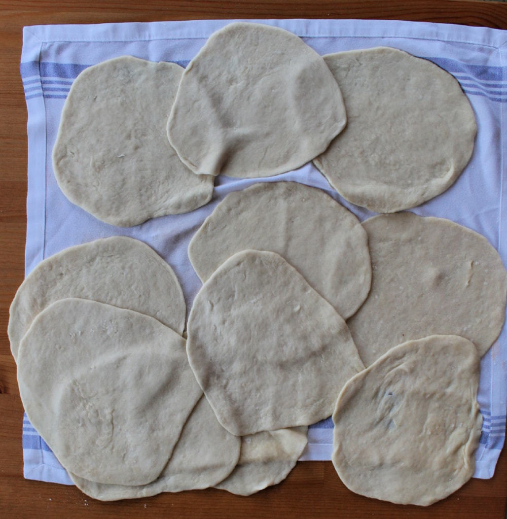 Rolled out dough on a kitchen towel.