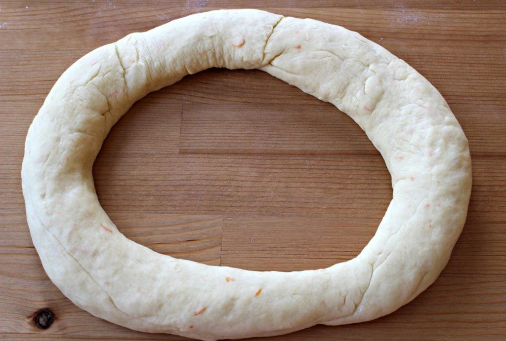 Unbaked dough formed in an oval shape.