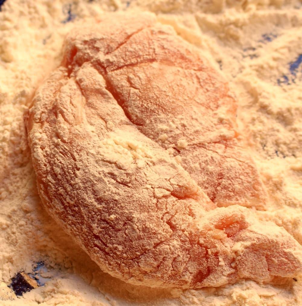 Chicken dredged in flour.