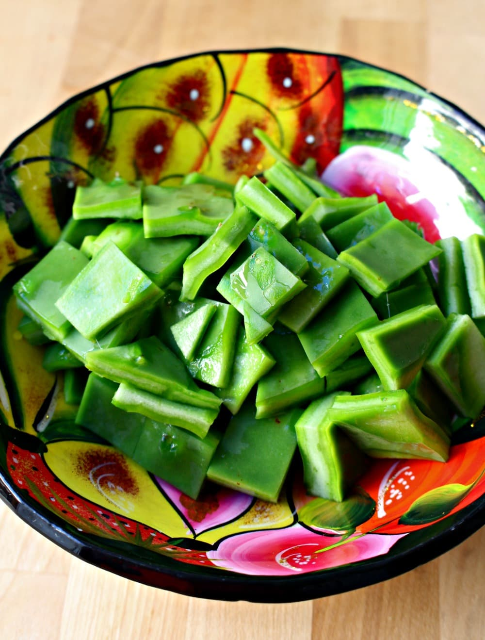 Diced nopales (or cactus) on a decorative and colorful bowl.