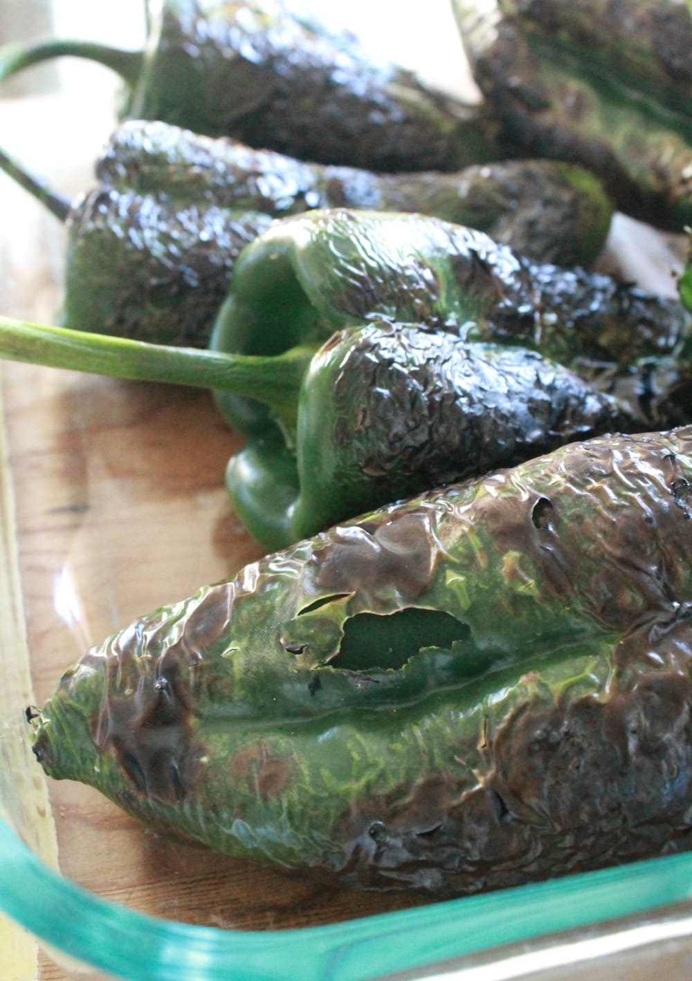Roasted Poblano Peppers in a glass dish.