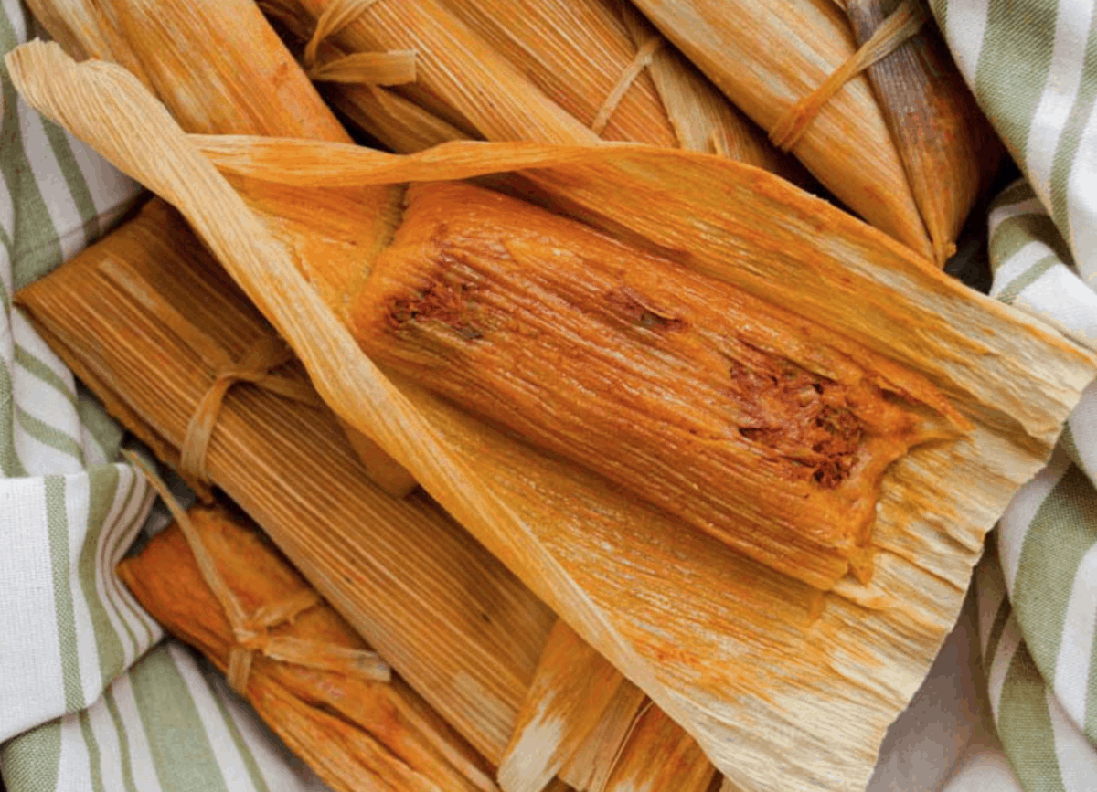 These red chile jackfruit tamales are made with spicy guajillo chile seasoned jackfruit and masa, stuffed inside corn husks and steamed to perfection.