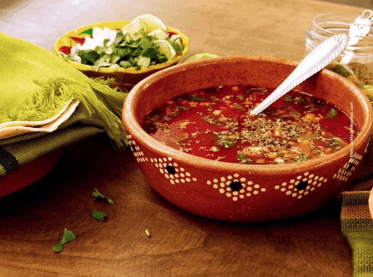 Vegan Menudo in a red clay bowl.