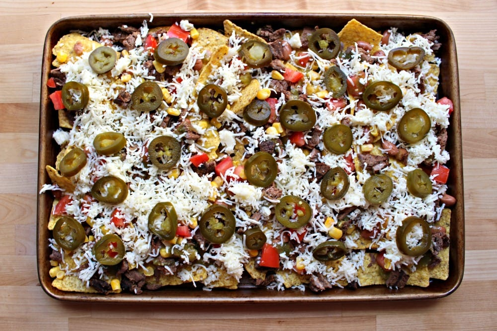 Carne asada nachos ready to go into the oven.