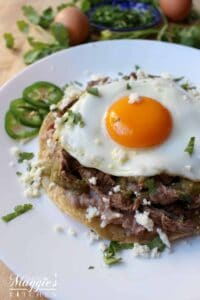 Steak Huevos Rancheros, Huevos Rancheros con Bistec, topped with cilantro and queso fresco.