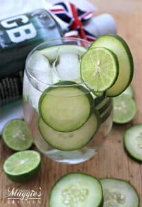 Cucumber Gin Cocktail served in a clear glass and surrounded by cucumber and lime slices.