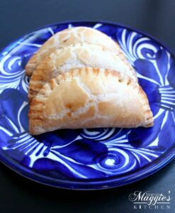 Empanadas de Queso on a decorative Mexican blue plate.