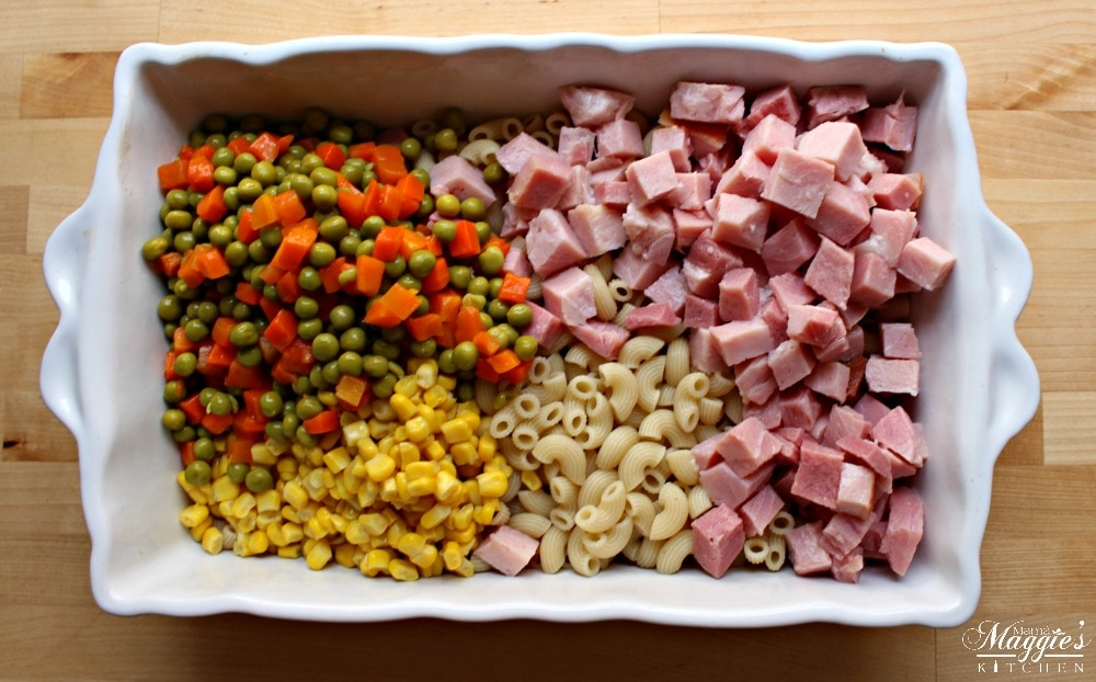 The ingredients for Ensalada de Coditos in a white rectangular container.