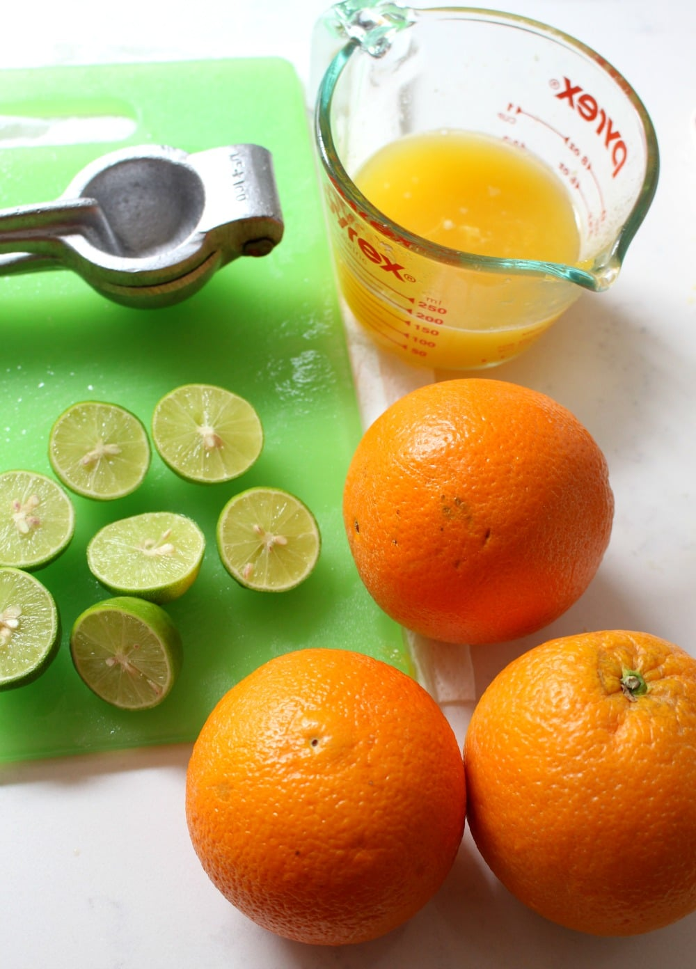 Oranges and limes being juiced.