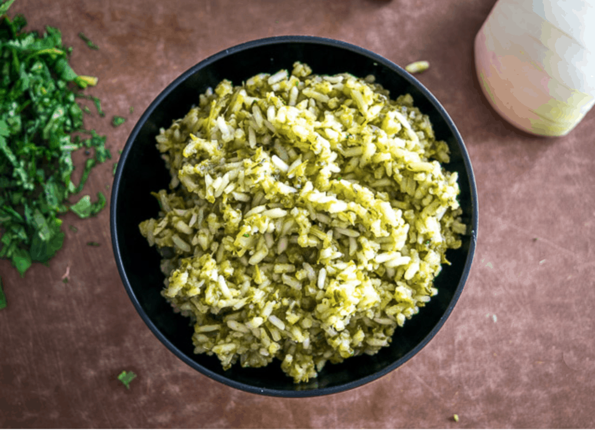 Mexican Green Rice in a black bowl.